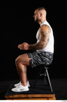 Grigory  1 camo shorts dressed sitting sports white sneakers white tank top whole body 0009.jpg